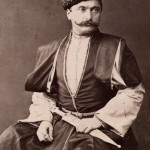 An Armenian man in traditional clothing poses for a portrait. Location: Lesser Caucasus, Eastern Europe. Photographer: GEORGE KENNAN/National Geographic Stock